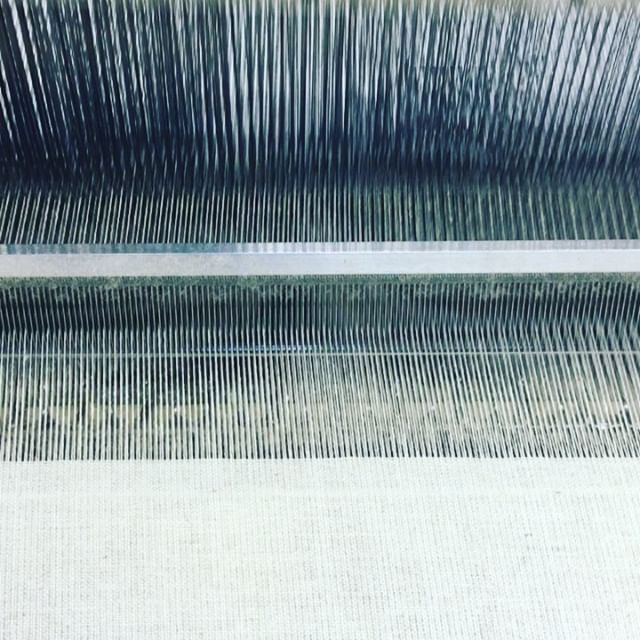 There's something hypnotic about watching a loom in action. #weaving #weavingwednesday #textiles #textilemill