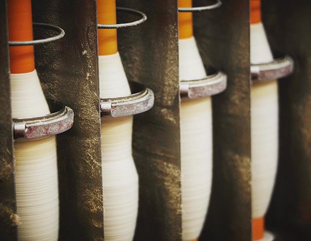 Spinning: The slubbings produced during the carding process are converted into yarn by applying a specific degree of fineness and permanent twist. The degree of fineness of the spun yarn is usually described by a numerical system of measurement called a count system. #weavingprocess #choosewool #wool #textilemill #clothmerchant #hainsworth