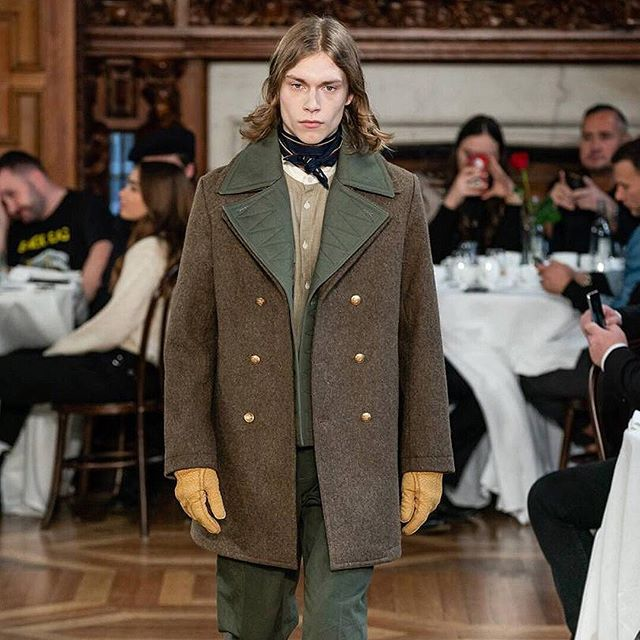 Hainsworth #TrueHeritage fabrics spotted at #lfwm. Taking inspiration from formal dress codes in post WW1 Britain, @kentandcurwen's #AW19 collection included this #military style coat in #Hainsworth #RENKhaki – a traditional uniform cloth as worn by the British Military during WW1.