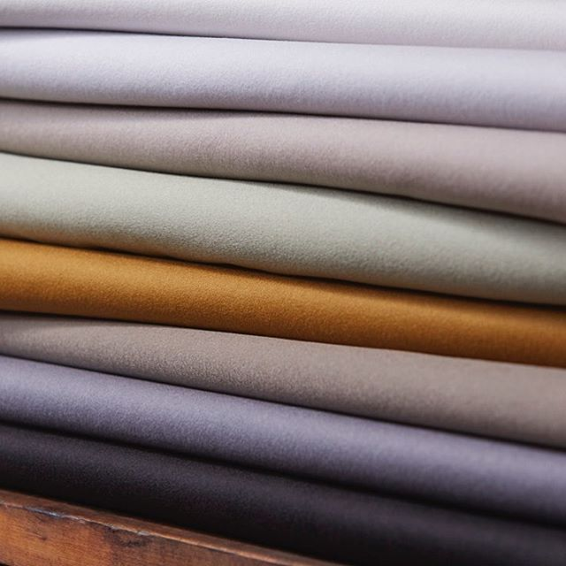 #InteriorsRediscovered. Broadcloth is a tightly woven and felted woollen cloth, regarded for its lustrous quality and sheen, perfect for accentuating the curves and folds of upholstered furniture and drapery. Its diverse colour palette ensures versatility of project use from modern colour statement pieces to relaxed neutral havens. #Hainsworth Broadcloth is the widest woollen faced fabric on the market at 220cms. Browse the collection and order samples via our website (link in bio). All colours are stock supported and available to order from just 2 metres. #fabricofanation #furnishingfabrics #textilefabrics #upholsteryfabric #upholsteryfabrics #interiorfabrics #interiordesign #interiordesigner